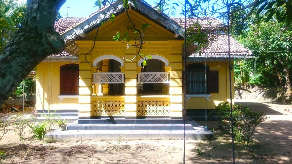 Pretty Colonial House among Paddy Fields